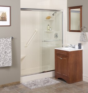 View of a neutral toned modern bathroom, featuring a glass-enclosed shower