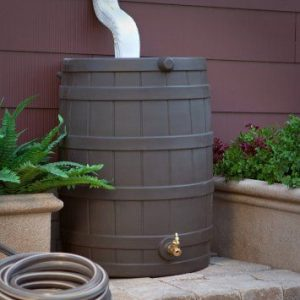 A brown rain barrel on a deck