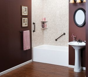 View of a brown toned bathroom, featuring a bathtub with shelves and grab bars