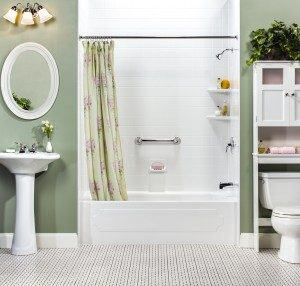View of a green and white colored modern bathroom, featuring a traditional bathtub and shower combination
