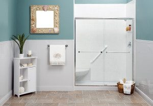 View of a beach themed bathroom, featuring an accessible glass-enclosed shower