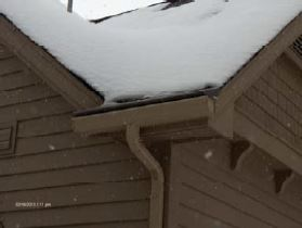 After Helmet Heat, with no snow or ice around the roof line and gutters