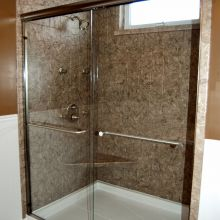 An accessible glass-enclosed shower