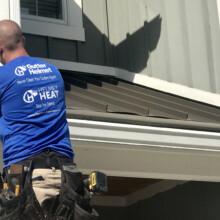 Rainbow Seamless employee installing gutters